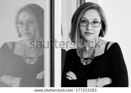 Closeup portrait of attractive middle aged woman, selective focus - stock photo