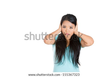 Closeup portrait of attractive woman covering her ears isolated on white background with copy space. Hear no evil concept - stock photo