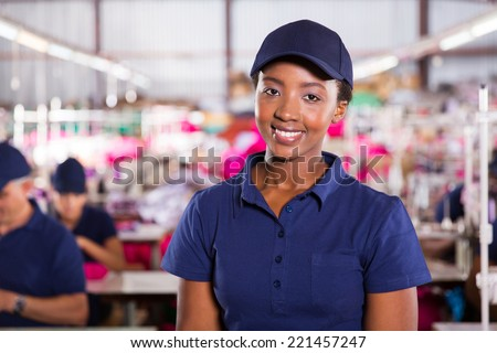 closeup portrait of beautiful african textile worker in factory - stock photo