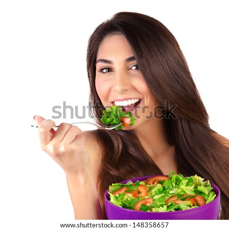 Closeup portrait of beautiful brunette woman eating salad isolated on white background, organic food, healthy lifestyle, dieting concept - stock photo