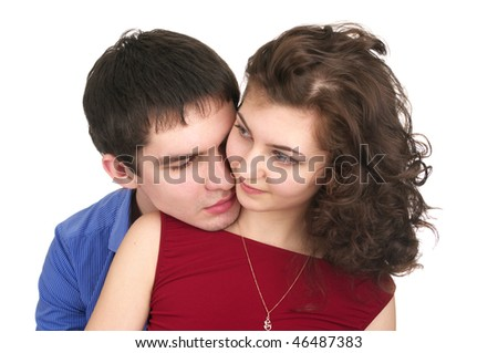 Closeup portrait of beautiful couple isolated over white background - stock photo