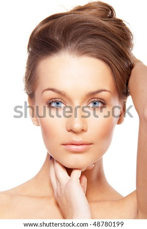 Closeup portrait of beautiful female model with blue eyes on white background - stock photo