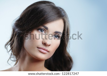 Closeup portrait of beautiful girl with perfect clear skin and natural makeup - stock photo