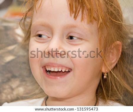 Closeup portrait of beautiful little girl smiling - stock photo