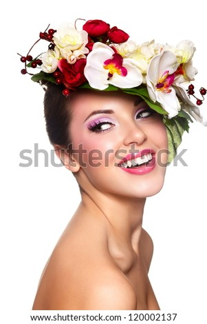 closeup portrait of beautiful sexy smiling brunette caucasian young woman model with glamour lips,bright makeup. With colorful flowers on head - stock photo