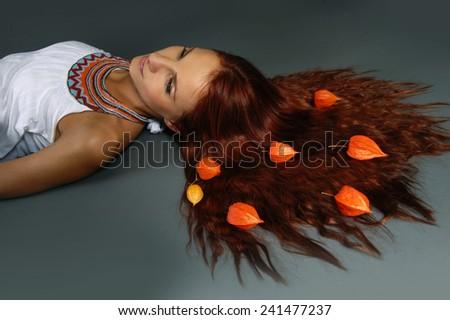 closeup portrait of beautiful woman on the grey - stock photo