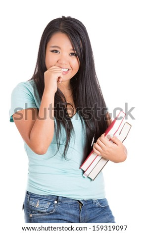 Closeup portrait of beautiful woman student holding books with finger in mouth, isolated on white background  - stock photo