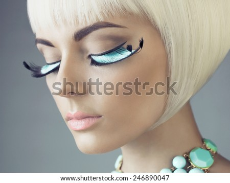 Closeup portrait of beautiful woman with color eyelashes - stock photo