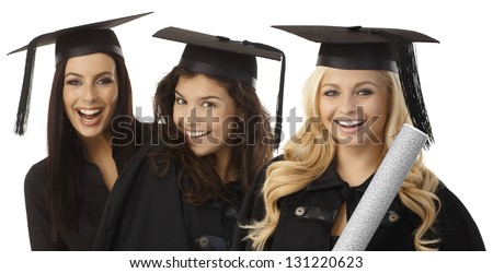Closeup portrait of beautiful young female graduates in square academic cap smiling happy holding diploma. - stock photo