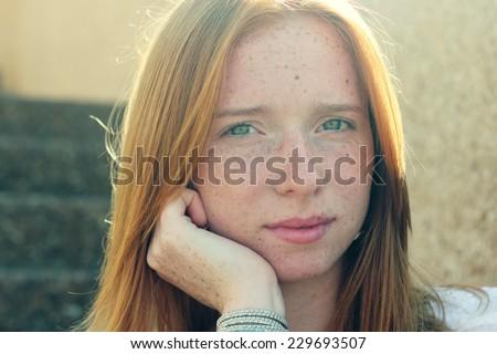 Closeup portrait of beautiful young redhead girl - stock photo