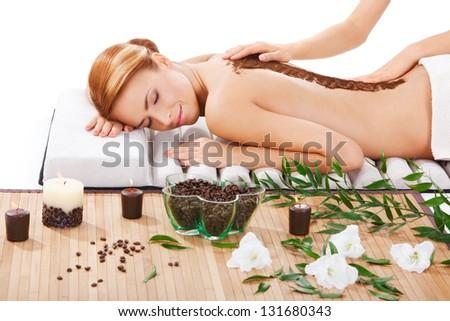closeup portrait of beautiful young woman getting back massage at spa - stock photo