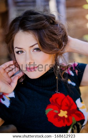 Closeup portrait of beautiful young woman lying on floor and looking at you  - stock photo