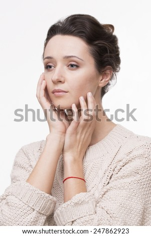 Closeup portrait of beautiful young woman touching her face. Isolated on white background. - stock photo