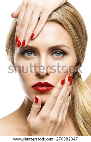Closeup portrait of beautiful young woman with perfect makeup, red lips and nail polish. Isolated over white background - stock photo