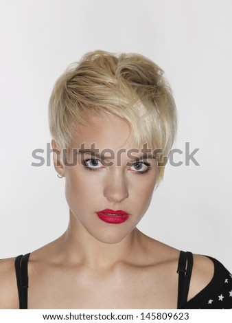 Closeup portrait of beautiful young woman with red lips on white background - stock photo