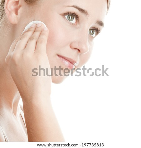 Closeup portrait of beauty woman removing makeup - stock photo