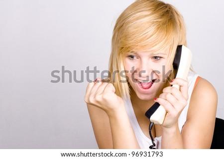 closeup portrait of blond woman with retro telephone - stock photo