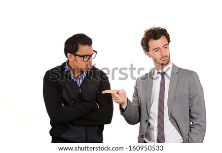 Closeup portrait of boss pointing for worker to leave office, fired. Worker is pissed, annoyed, upset, angry and irritated.  Government shutdown or business downsizing. Isolated on white background - stock photo