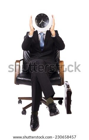 Closeup portrait of businessman covering his face with a wall clock isolated on white background  - stock photo