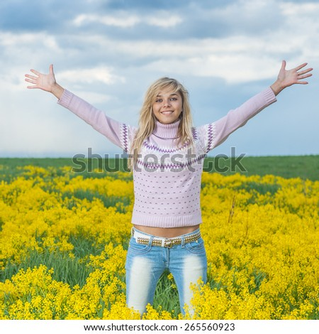 closeup portrait of charming, lovely woman standing with his arms crossed, smiling, on green background - stock photo