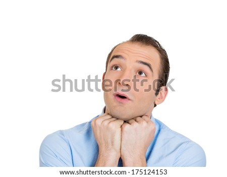 Closeup portrait of charming upbeat smiling joyful happy young man looking upwards with chin on fist daydreaming, isolated on white background. Positive emotion facial expression feelings, attitude - stock photo