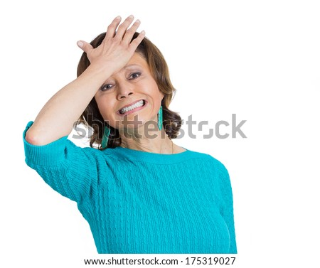 Closeup portrait of confused senior mature woman placing hand on head, palm on face gesture in duh moment, isolated on white background. Negative emotion facial expression feelings, body language - stock photo