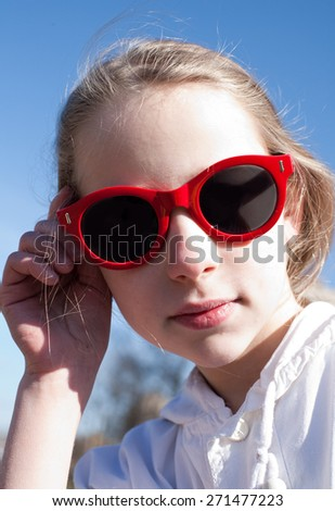 closeup portrait of cool young girl in big sunglasses - stock photo