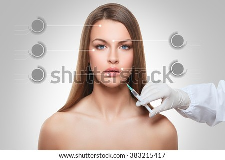 closeup portrait of cosmetic botox injection in the female face lip zone  - stock photo