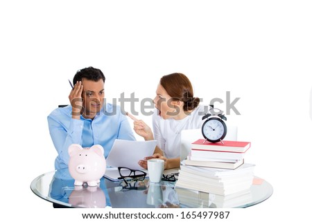 Closeup portrait of couple, man, woman, distressed from financial problem, mounting bills, isolated on white background. Bad market decisions. Wife angry, unhappy with reckless spending of her husband - stock photo