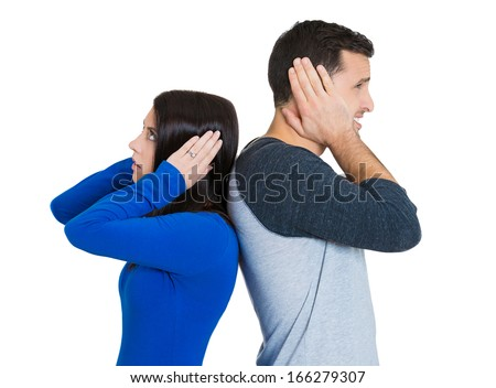 Closeup portrait of couple, man woman standing with backs together, covering ears, opened eyes, not listening to each other isolated on white background. Negative human emotions facial expressions - stock photo