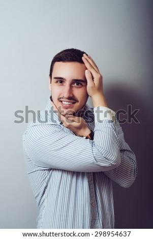 Closeup portrait of crazy man  twisting arms around head in wacky ways - stock photo