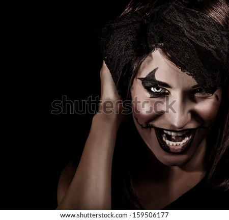 Closeup portrait of creepy vampire woman yelling, terrifying facial expression, open mouth, aggresive makeup, Halloween carnival concept - stock photo