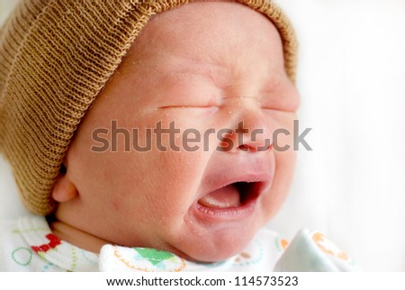 Closeup portrait of cute little baby boy crying - stock photo