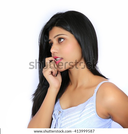Closeup portrait of cute pretty smiling young indian woman thinking hand on chin looking up having an idea, isolated on white background. - stock photo