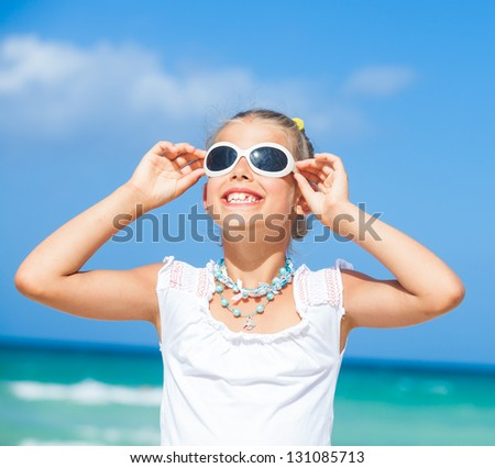 Closeup portrait of cute teens girl in sunglasses relax ocean background - stock photo