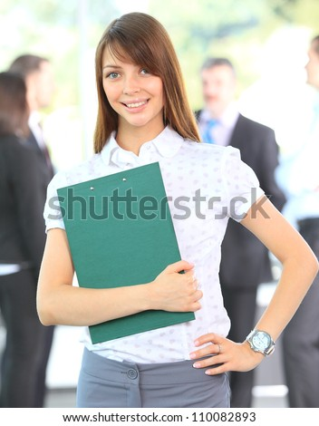 Closeup portrait of cute young business woman smiling - stock photo