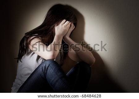 Closeup portrait of depressed teenager girl cover her face. - stock photo