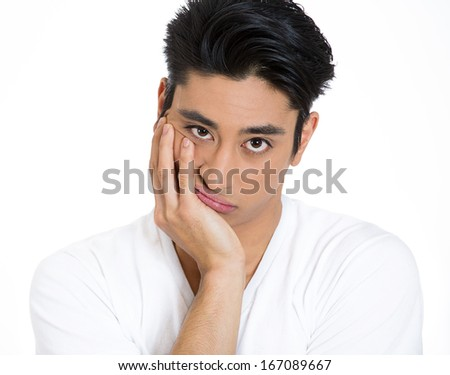 Closeup portrait of displeased pissed off, angry grumpy man with bad attitude, chin on hand looking at you camera , isolated on white background . Negative human emotion facial expression feeling - stock photo