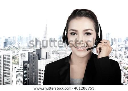 Closeup portrait of female call center operator wearing headset - stock photo