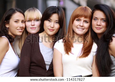 Closeup portrait of five urban women outside - stock photo