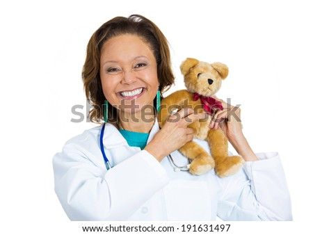Closeup portrait of friendly smiling confident senior female doctor holding teddy bear, isolated white background. Patient visit. Health care reform. Positive human face expression, emotion, attitude - stock photo
