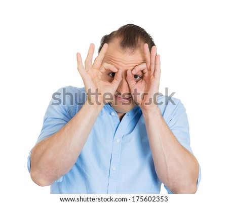 Closeup portrait of funny guy, young sarcastic business man giving two ok signs with fingers, looking through like binoculars, isolated on white background. Human face expressions, emotions, reaction - stock photo