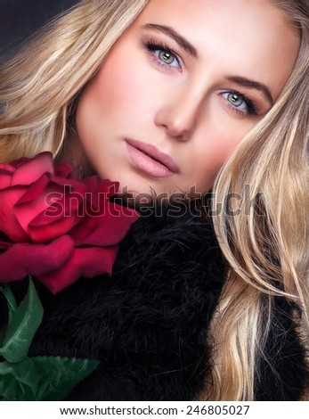 Closeup portrait of gorgeous stylish woman with beautiful blond hair and fresh red rose, fashion lifestyle, beauty and vogue concept - stock photo