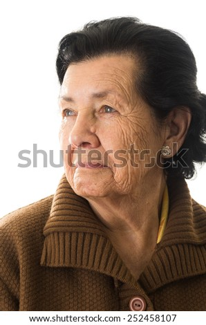 closeup portrait of grandmother looking to the side nostalgic - stock photo