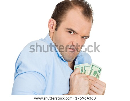 Closeup portrait of greedy banker executive CEO boss, corporate employee funny looking man, shaking holding dollar banknotes scared to loose money, suspicious isolated on white background. Expressions - stock photo
