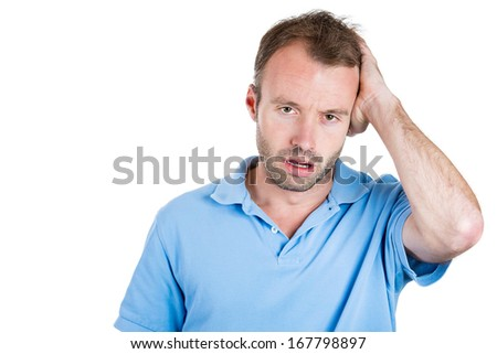 Closeup portrait of groggy upset, worried, sad depressed, tired business man with headache, very stressed hand in hair, isolated on white background. Negative human emotion facial expression, feelings - stock photo