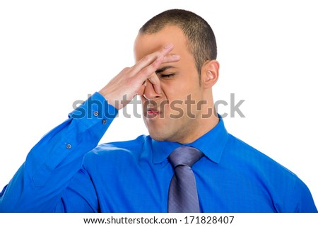 Closeup portrait of handsome guy, businessman closing nose, something stinks, isolated on white background.Negative human face expressions, emotions, feelings, reaction, attitude, behavior, perception - stock photo