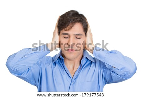 Closeup portrait of handsome peaceful, tranquil, looking relaxed, young business man covering his ears, closing eyes, isolated white background. Hear no evil concept. Human emotion, facial expressions - stock photo