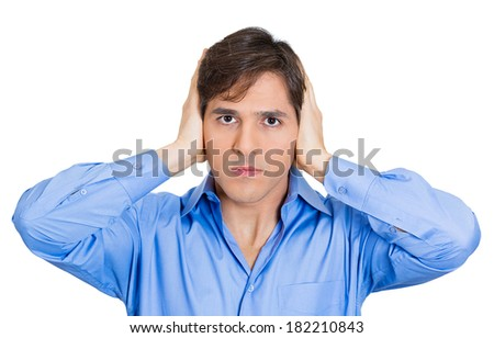 Closeup portrait of handsome peaceful, tranquil, looking relaxed, young business man covering his ears, observing, isolated white background. Hear no evil concept. Human emotion, facial expressions - stock photo