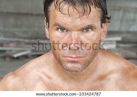 Closeup portrait of handsome rugged Caucasian male worker covered in dirt and sweat - stock photo